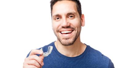 Man getting ready to place his Invisalign tray