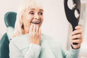 older woman smiling wearing dentures